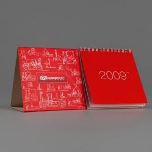 Перекидной настольный календарь с навивкой на пружину
